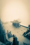 Chin Swee Caves Temple in the fog. A blanket of fog covers the Chin Swee Caves Temple near Kuala Lumpur in Malaysia. This eerie duotone image shrouds the Taoist stock photos