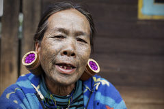 Chin tribe tattoed woman (Daai). MINDAT, MYANMAR - DECEMBER 6: Chin tribe tattoed woman (Daai) with huge bamboo earrings poses for a photo on December 6, 2015 royalty free stock photos