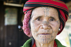 Chin tribe tattoed woman. KANPETLET MYANMAR, DECEMBER 9: Chin tribe tattoed woman (Muun) poses for a photo on December 9, 2015 Kanpetlet, Myanmar. Also known as royalty free stock photography