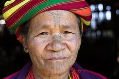 Chin tribe tattoed woman. KANPETLET MYANMAR, DECEMBER 9: Chin tribe tattoed woman (Muun) poses for a photo on December 9, 2015 Kanpetlet, Myanmar. Also known as stock images