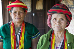 Chin tribe tattoed woman. KANPETLET MYANMAR, DECEMBER 9: Chin tribe tattoed woman (Muun) poses for a photo with her daughter on December 9, 2015 Kanpetlet royalty free stock photography
