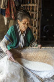 Chin tribe tattoed woman (Muun). MINDAT, MYANMAR - DECEMBER 7: Chin tribe tattoed woman (Muun) sorts out the rice harvest on December 7, 2015 Mindat, Myanmar stock image