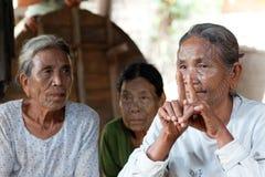 Chin tribe tattoed women. MRAUK U, MYANMAR - JANUARY 04: Chin tribe tattoed women poses for a photo on January 04, 2012 in Mrauk U, Rakhain State, Myanmar stock photography