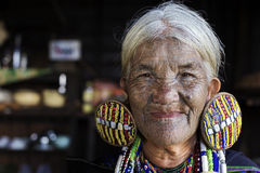 Chin tribe tattooed woman (Daai). MINDAT, MYANMAR - DECEMBER 6: Chin tribe tattoed woman (Daai) poses for a photo on December 6, 2015 Mindat, Myanmar. Chin royalty free stock photography