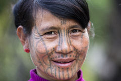 Chin tribe tattooed woman (Muun). MINDAT, MYANMAR - DECEMBER 7: Chin tribe tattooed woman (Muun) poses for a photo on December 7, 2015 Mindat, Myanmar. Chin stock photography