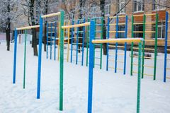 Chin-up bars covered with heavy snow close-up stock photos