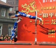 China acrobatics. China acrobatics at dragon raising-head temple fair He-ping Tianjin China photoed on march 2nd 2014 Royalty Free Stock Image