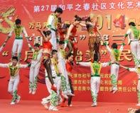China acrobatics. China acrobatics at dragon raising-head temple fair He-ping Tianjin China photoed on march 2nd 2014 Royalty Free Stock Images