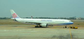 China Airlines airplane on runway at Tan Son Nhat airport, Vietnam Royalty Free Stock Images