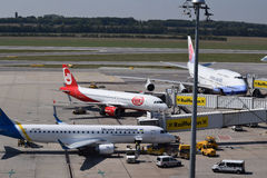 China Airlines Boeing 747-400, Niki Aiirbus a320 and Ukraine International Airlines Embraer erj190 parked at gate at Vienna Airpor. This is the perfect way to Royalty Free Stock Photo