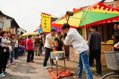China ancient shopping street. Crunchy candy,is Chinese famous snack,hammered with big mallet.Travel  in China ancient shopping street,Qibao old street as Royalty Free Stock Photos