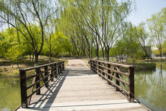 China Asia, Beijing, the Olympic Forest Park, garden landscape,The wooden bridge Royalty Free Stock Photo