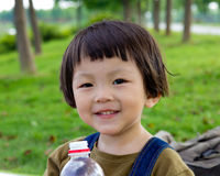 China baby. Chinese girl outdoors in summer and grass Royalty Free Stock Image