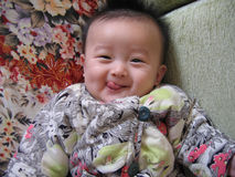 "China baby. The baby pull on the China cloths——""mianao Stock Images"