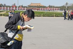 China, Beijing - April 8, 2012. A Chinese tourist in Beijing looks at the map.  stock images