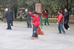 China, Beijing - April 10, 2012. Qigong in China. Qigong in the park Temple of the sky royalty free stock photos
