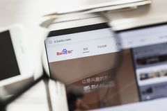 China, Beijing - 7 March 2019: Baidu, Search system official website homepage under magnifying glass. Concept Baidu. Search system logo visible on tablet royalty free stock photography