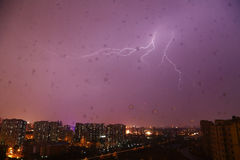 China Beijing rainy night lightning. At home, the window suddenly began to rain, and lightning, and the scenery is beautiful Stock Photos