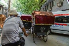China, Beijing. Ride on trishaw Stock Photo