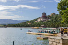 China, Beijing. Summer Imperial Palace. Kunming Lake, Longevity Hill and Temple (tower) Foxiangge, berths for boats Royalty Free Stock Image