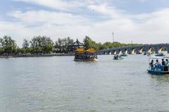 China, Beijing. Summer Imperial Palace. Kunming Lake and Seventeen Arch Bridge, boats Royalty Free Stock Image