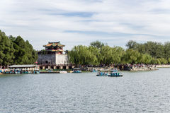 China, Beijing. Summer Palace. Fortress tower with a pagoda on the shore of Kunming Lake Royalty Free Stock Images