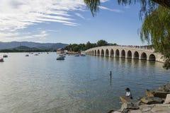 China, Beijing. Summer Palace. View of Kunming Lake and Seventeen Arch bridge Stock Image