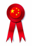 China Chinese orient Asia flag ribbon prize. China and Chinese flag ribbon prize award for excellence representing a crest of accomplishment and trade goals Stock Photography