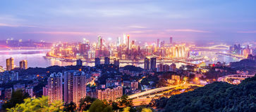 China Chongqing City Lights. Cityscape and skyline of downtown near water of chongqing at night Royalty Free Stock Photography