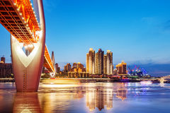 China Chongqing City Lights. Cityscape and skyline of downtown near water of chongqing at night Royalty Free Stock Images