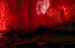 China concept chinese new year celebration background with chinese rooftops and fireworks with red smoke stock photos