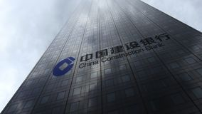 China Construction Bank logo on a skyscraper facade reflecting clouds. Editorial 3D rendering Royalty Free Stock Images
