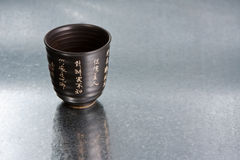 China cup. On silver background Stock Image