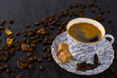China cup of coffee on black background Stock Photography