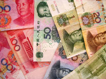 China Currency. China now is playing a more and more important role in the world and her currency appears more and more often in the economy filed. This is a Stock Photography