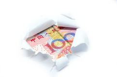 China currency through torn white paper Stock Image