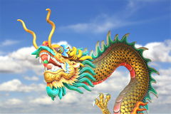 China dragon statue flying in the sky background stock photos