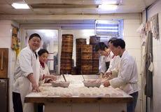 China: dumplings cooks. CHONGQING, CHINA - DEC 25: group of unidentified chinese cook preparing traditional dumplings in a restaurant in Chongqing, Dec 25, 2010 Stock Image