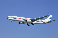 China Eastern Airbus A330-343X, B-6097 landing in Beijing, China Royalty Free Stock Photography