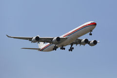 China Eastern Airlines Airbus A340 in New York sky before landing at JFK Airport Stock Image
