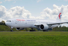 China Eastern Airlines Boeing 777-300ER taking off active runway Royalty Free Stock Photo