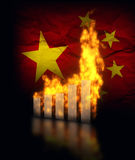 China Ecomy Crash. Es, burning graph charts against the Chinese flag Royalty Free Stock Photo