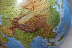 China en el mapa fotos de archivo
