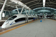 China - fast trains in Guangzhou. GUANGZHOU, CHINA - SEPTEMBER 29: China invests in fast and modern railway, trains with speed over 340 km/h. Train to Wuhan on stock image