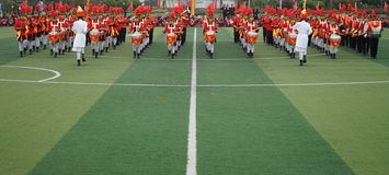 Chinese students join the juvenile team ceremony, drum trumpet team performance royalty free stock photography