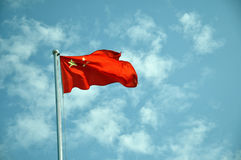 China flag. Flag of the People's Republic of China against blue clouds sky stock photography
