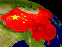 China with flag on Earth Stock Images