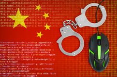China flag and handcuffed computer mouse. Combating computer crime, hackers and piracy. China flag and handcuffed modern backlit computer mouse. Creative concept royalty free stock image
