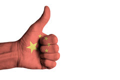 China flag on human male thumb up hand Stock Image