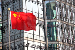 China flag with modern building. China flag on building background stock photography